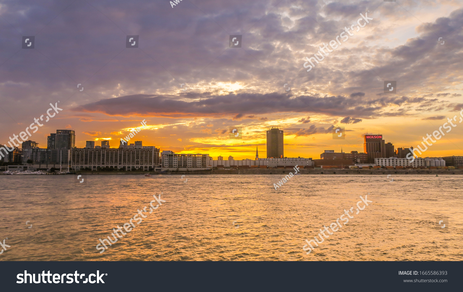 Montreal, Canada - july 2019: Sunset over the skyline of Montreal and the saint-laurent river from Jean Drapeau park