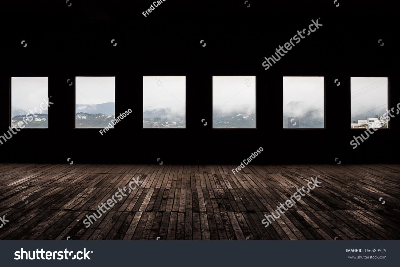 Dark room with light through window - Large Dark Room With Bright Light Coming In Through Windows