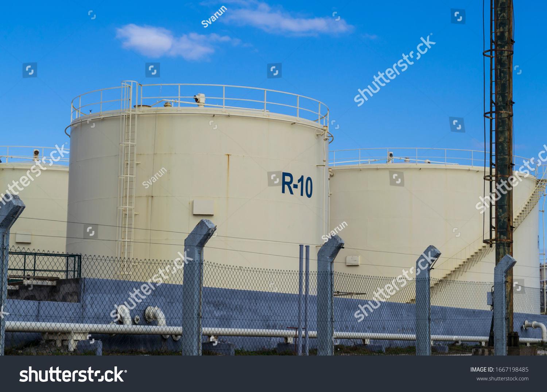 https://image.shutterstock.com/z/stock-photo-large-oil-and-gas-silos-and-pipeline-in-gazenica-industrial-zone-near-zadar-croatia-1667198485.jpg