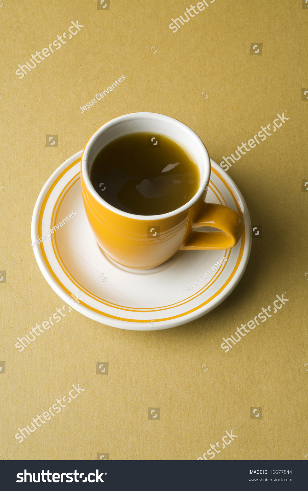 An orange coffee cup and plate