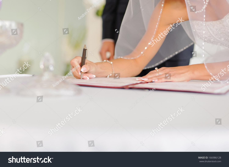 Bride elegant manicure signing certificate stock photo 166986128 bride with elegant manicure signing certificate xflitez Choice Image
