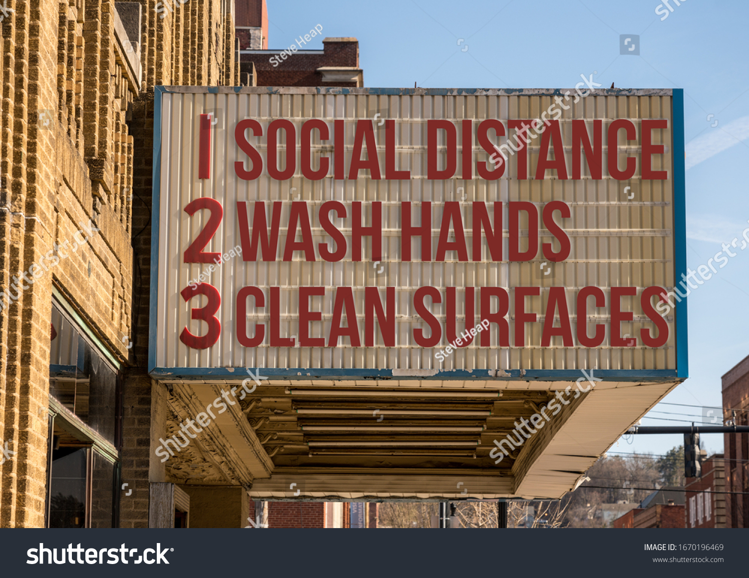 In this photo illustration of a movie cinema billboard with three basic rules to avoid the coronavirus or Covid-19 epidemic of wash hands, maintain social distance and clean surfaces #1670196469