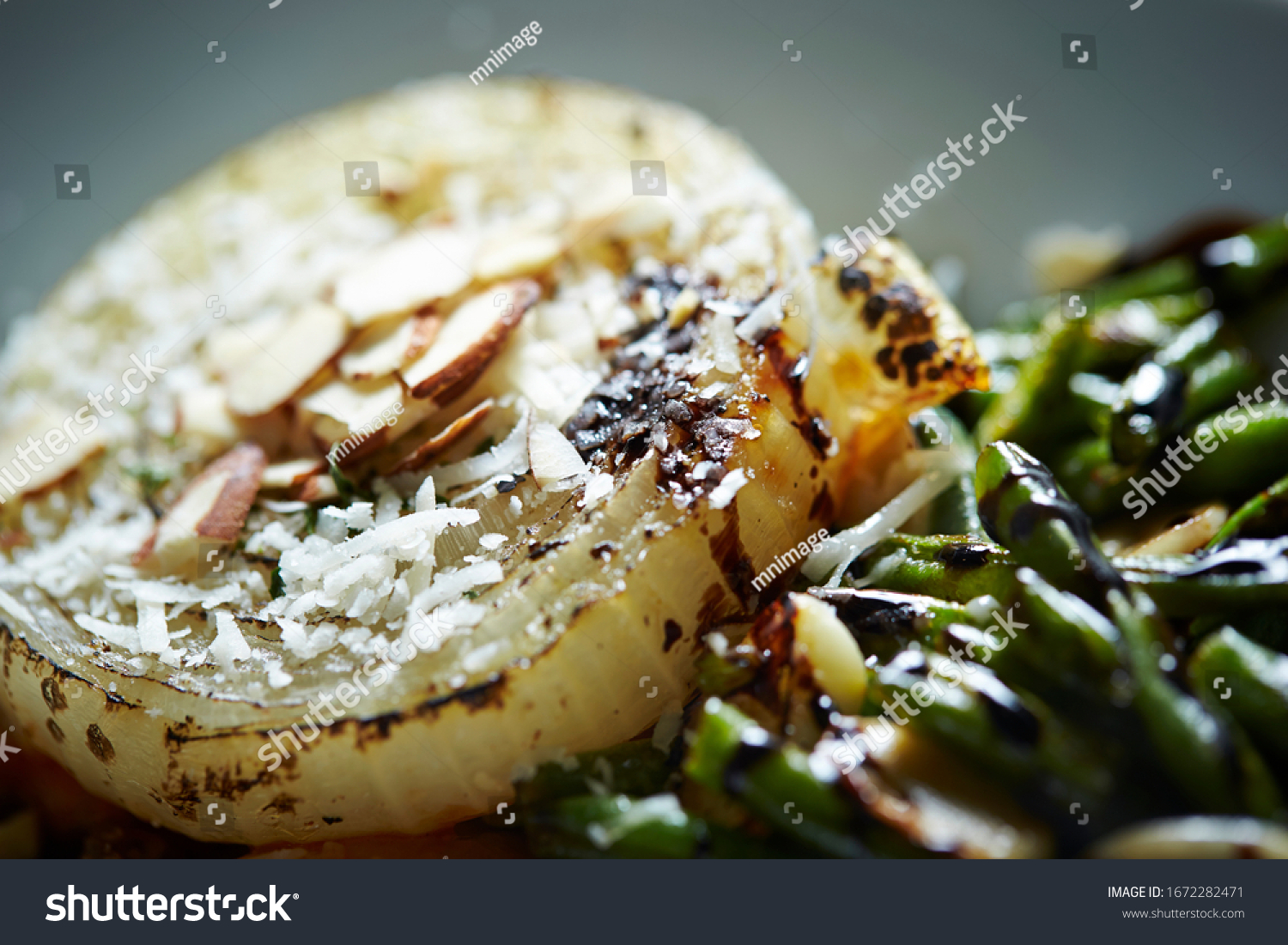 Grilled onion with cheese and almond nuts  #1672282471