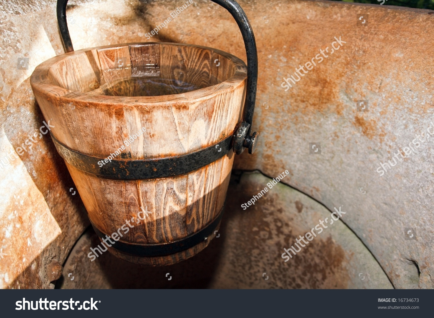 Wooden Bucket Of Water In Ancient Stone Well Stock Photo ...