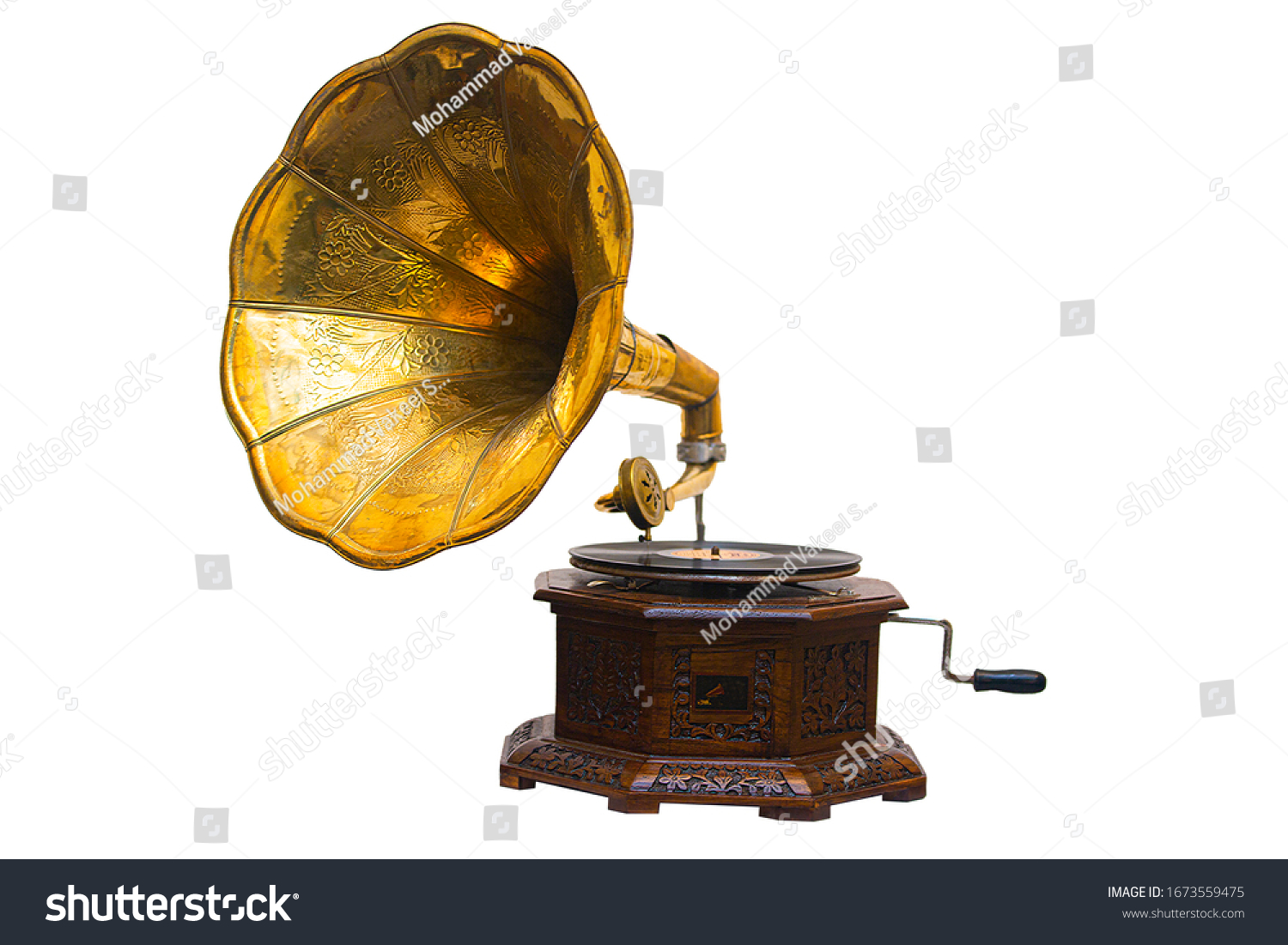 Old gramophone with plate or vinyl disk on wooden box isolated on white background. Antique brass record player.Gramophone with horn speaker. Retro entertainment concept.Gramophone is an Music device. #1673559475