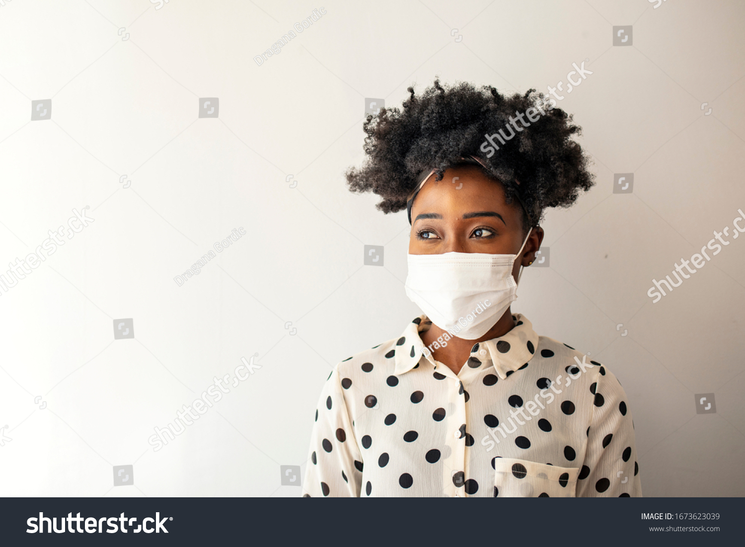 Masked woman - protection against influenza virus. African - American woman wearing mask for protect. Woman wear with protective face mask at home. Stop the virus and epidemic diseases. #1673623039