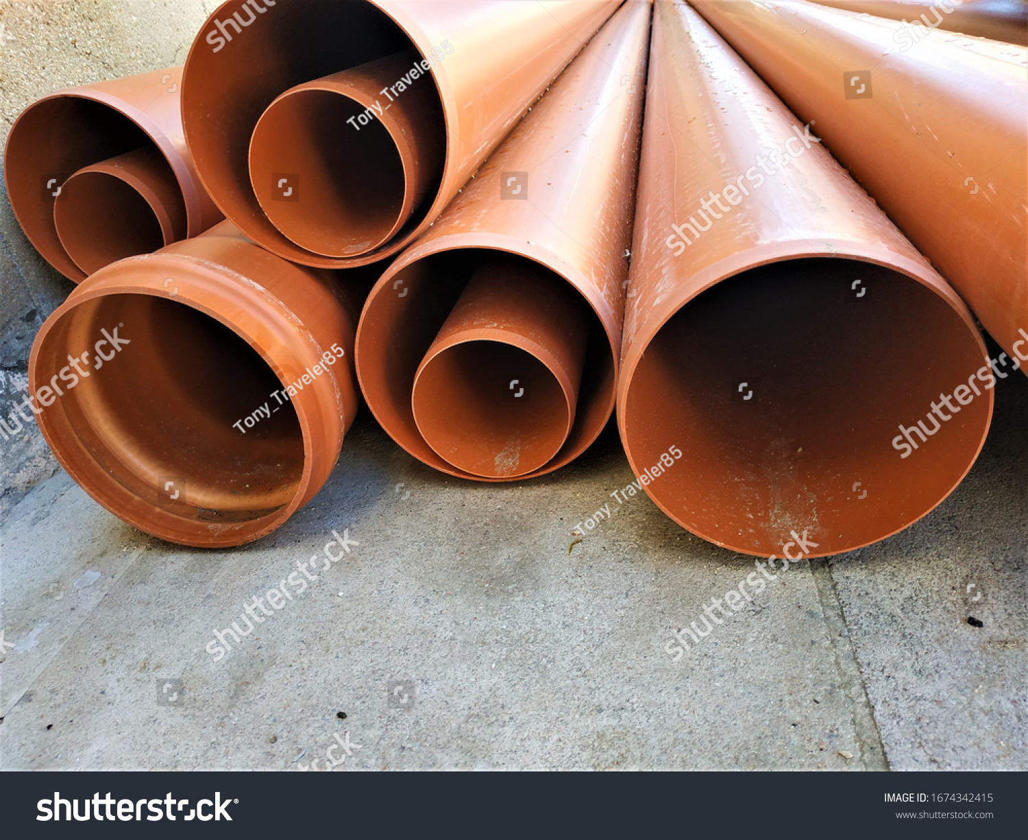 Large orange plastic pipes for sewerage system