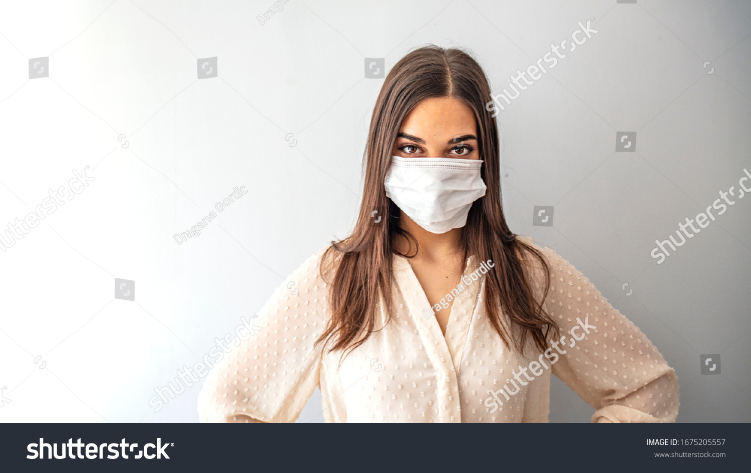Girl in respiratory mask. Masked woman looks at camera. Cold, flu, virus, tonsillitis, respiratory disease, quarantine, epidemic concept. Beautiful caucasian young woman with disposable face mask #1675205557