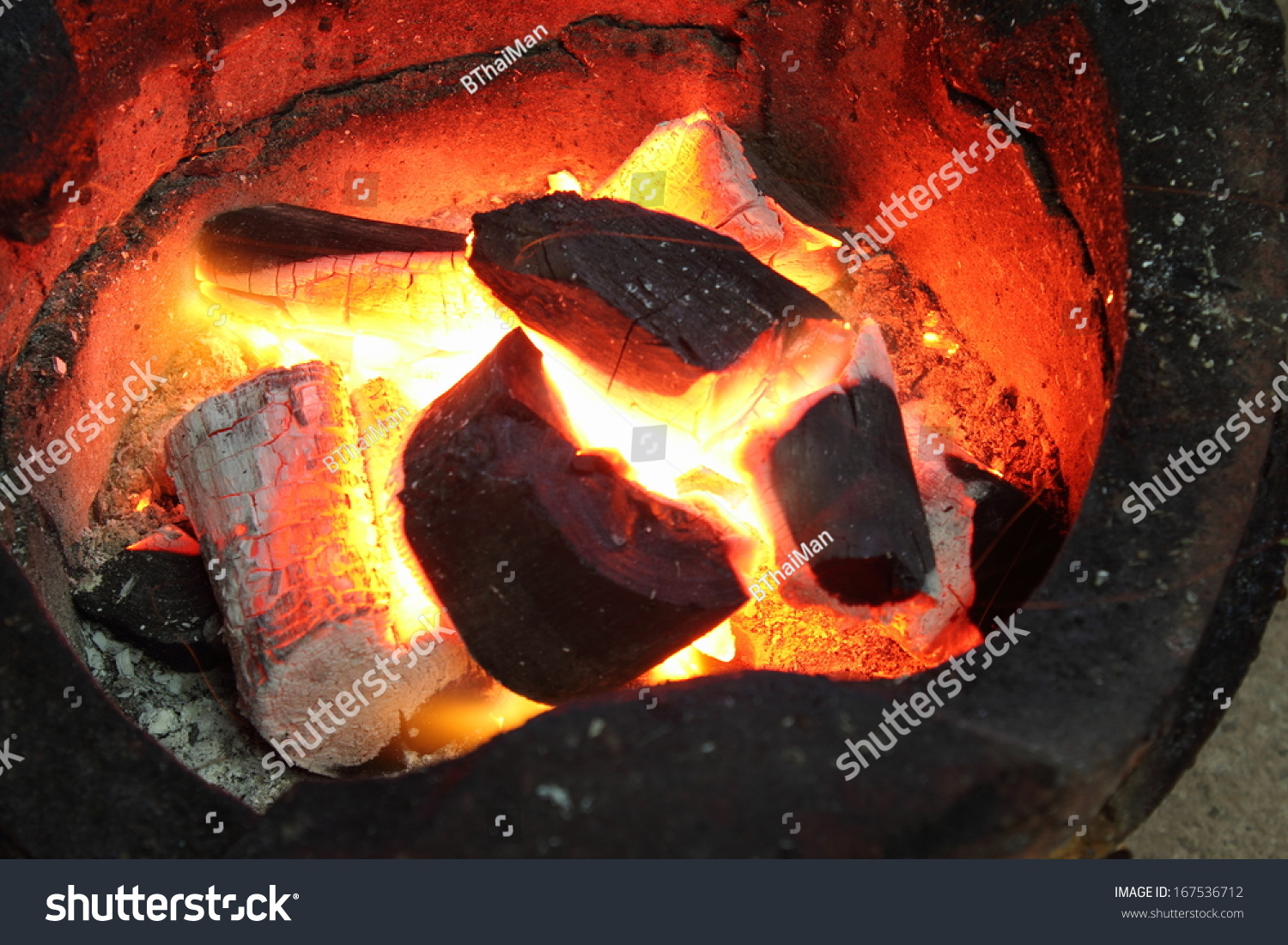 fire coals in the stove #167536712