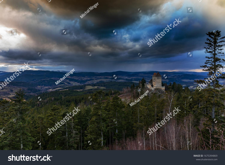 Old castle Kasper in the Czech republic middle county Sumava with dramatic sky sun set.