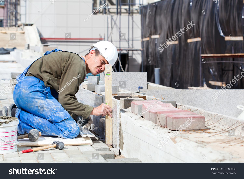 Marble Floor Construction : Tiler builder worker level measuring marble stock photo
