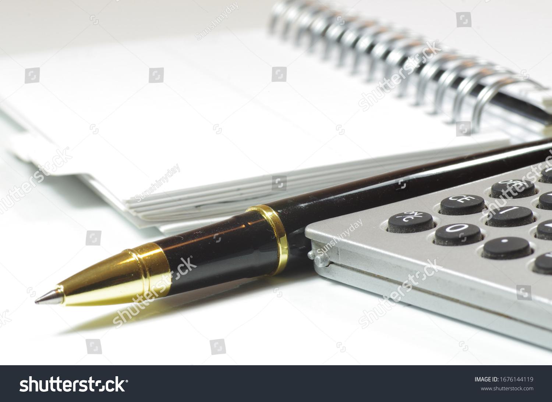 stock-photo-notebook-paper-pen-calculato