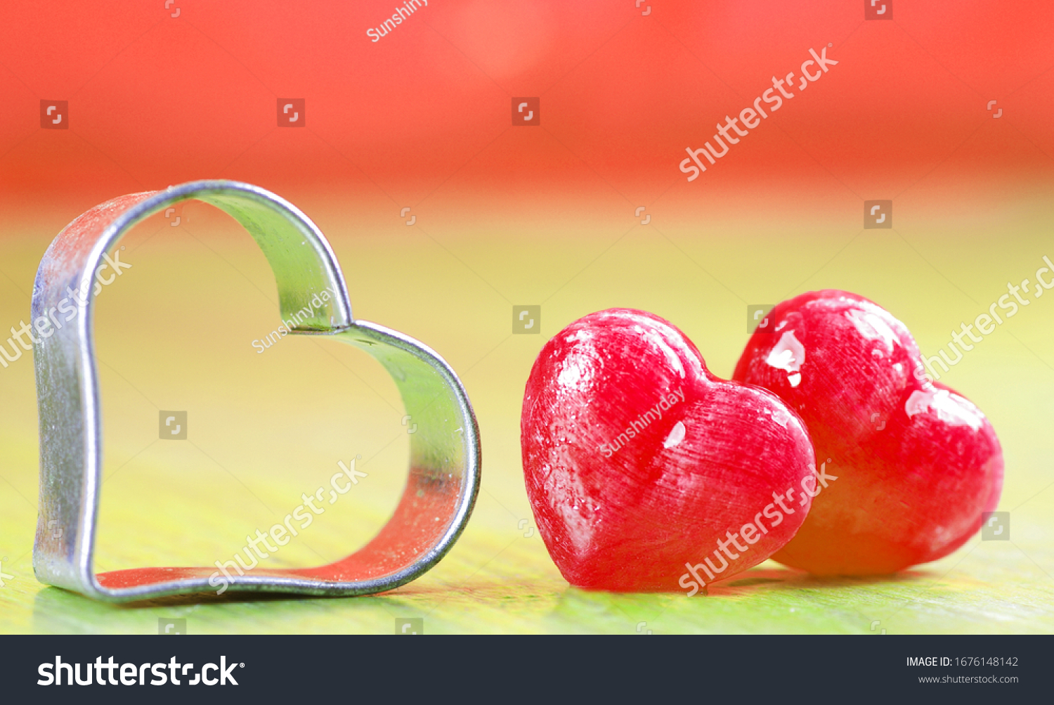 stock-photo-two-sweet-pink-candy-hearts-