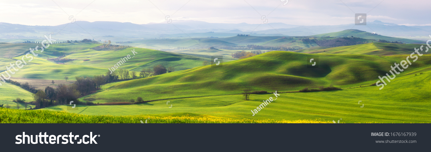 Amazing Tuscany panoramic landscape with green rolling hills in spring sunny morning #1676167939