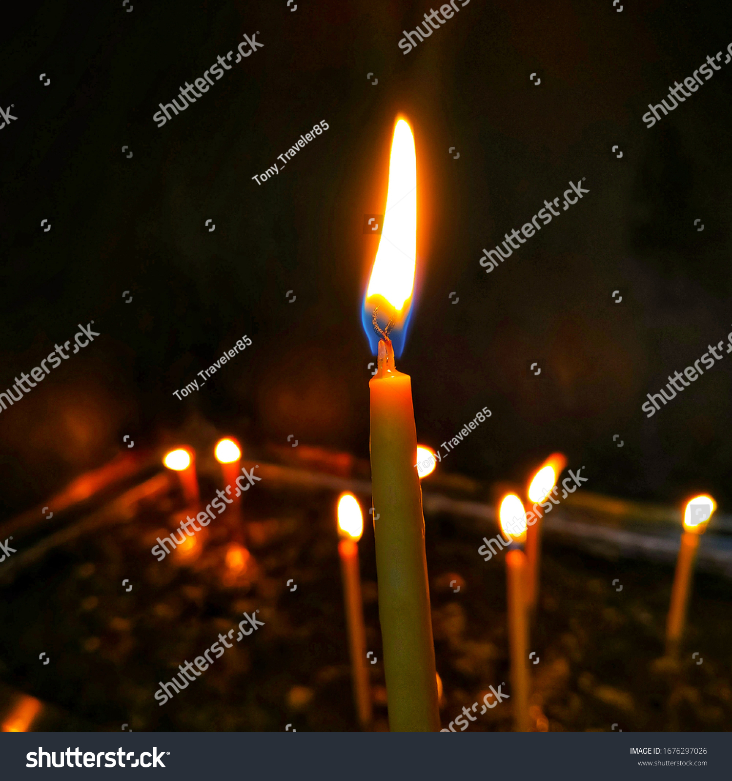 stock-photo-close-up-of-candles-light-wi
