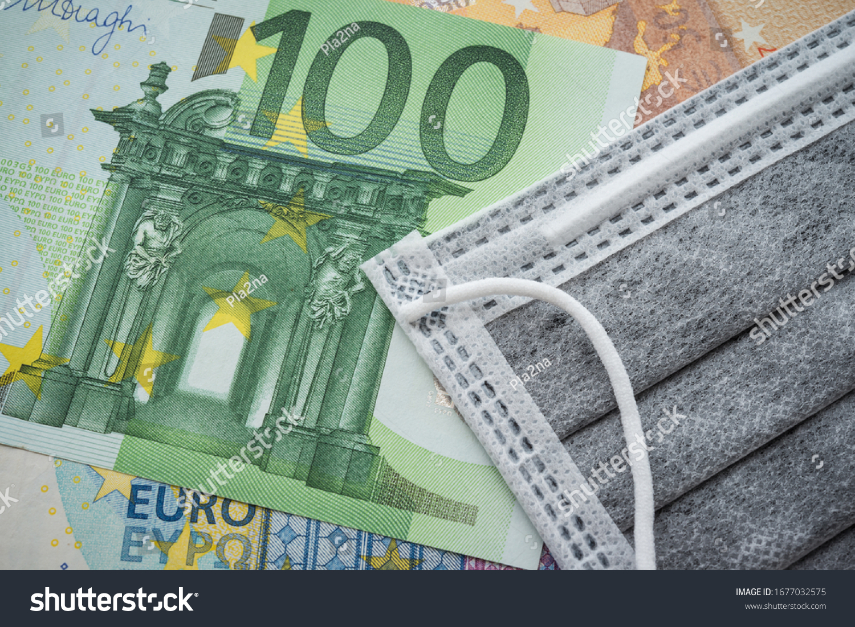 Face mask on Euro banknotes bill background. Global novel coronavirus (Covid-19) outbreak effect to EU, world economy, financial crisis, investment, stock market. Coronavirus pandemic in Europe, Euro. #1677032575
