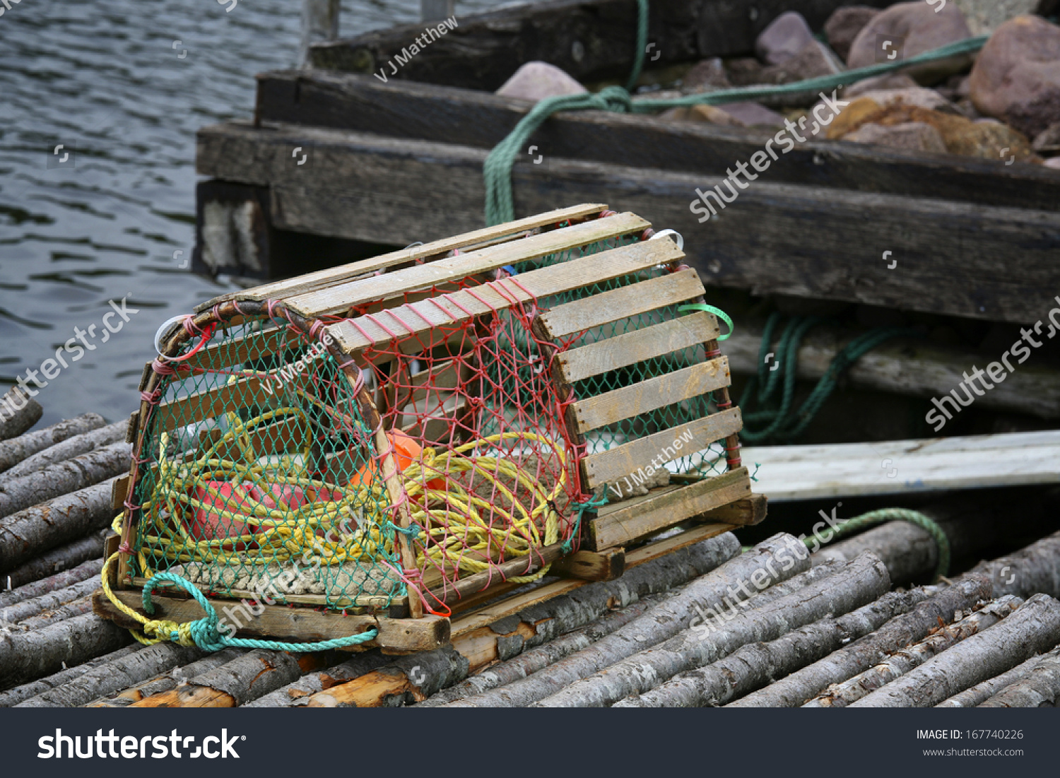A Wooden Lobster Trap With Buoys And Rope On A Newfoundland, Canada Wharf. Stock Photo 167740226 ...