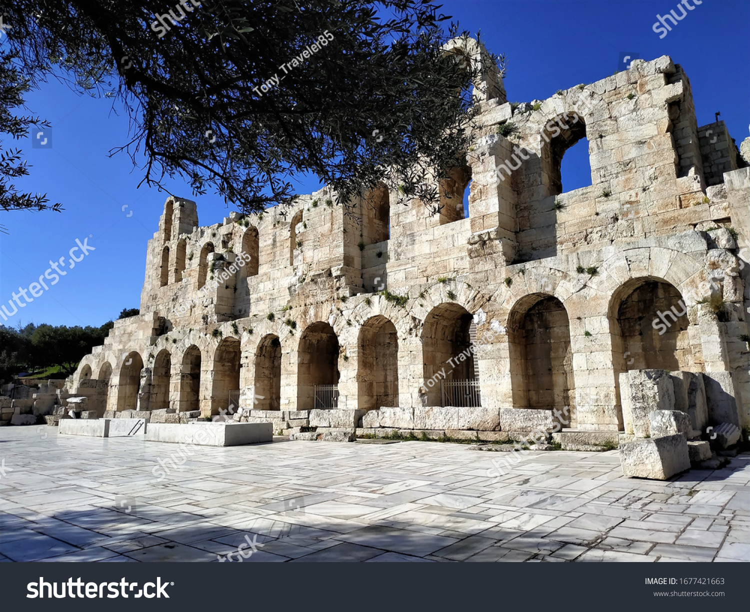 Athens, Greece - March 2020: Ancient Ruins of theatre of Dionysus in Athens, Greece and in the background the majestic Acropolis of Athens.
