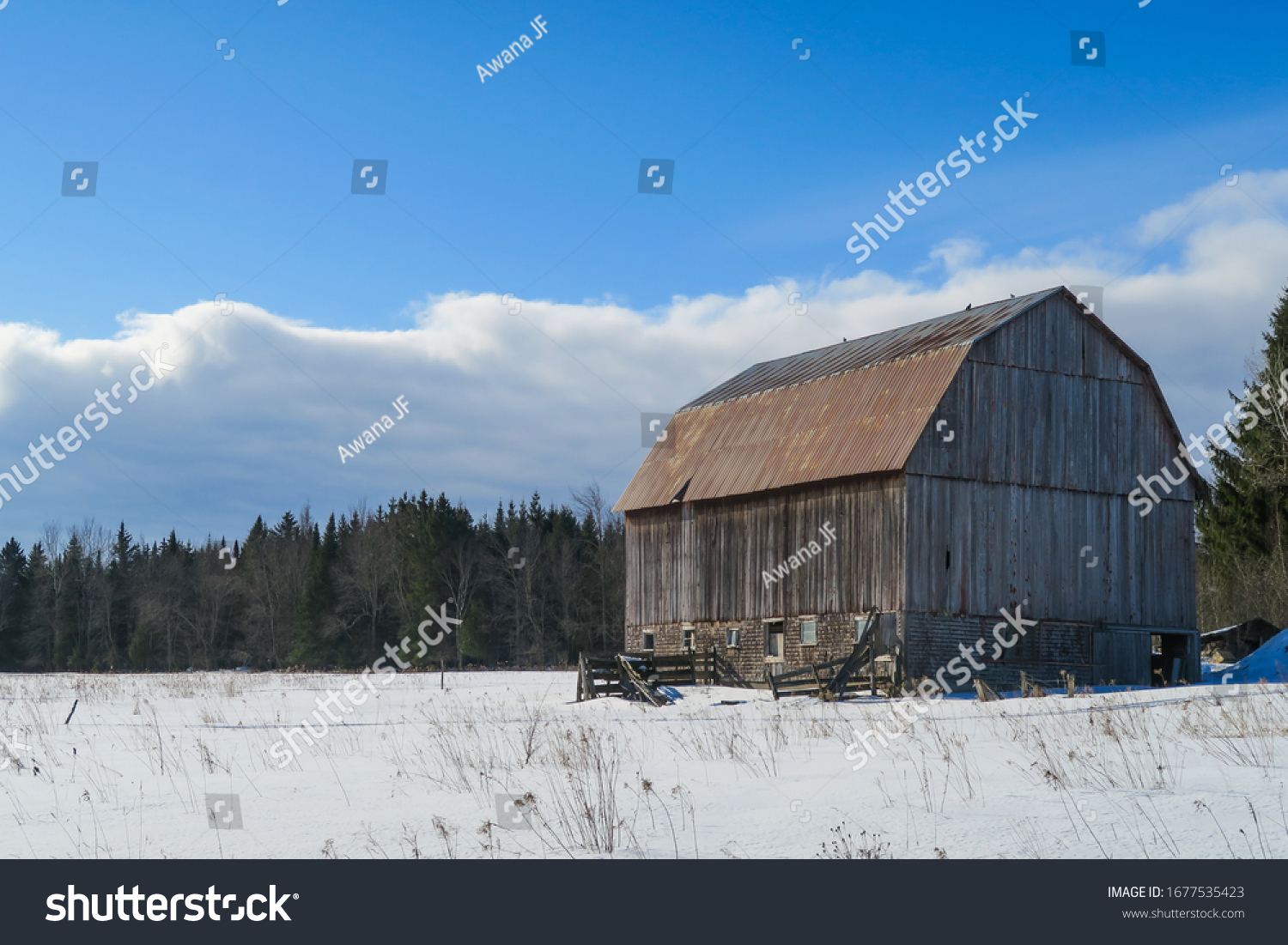 Winter landscape of an isolated abandoned farm lost in the eastern townships