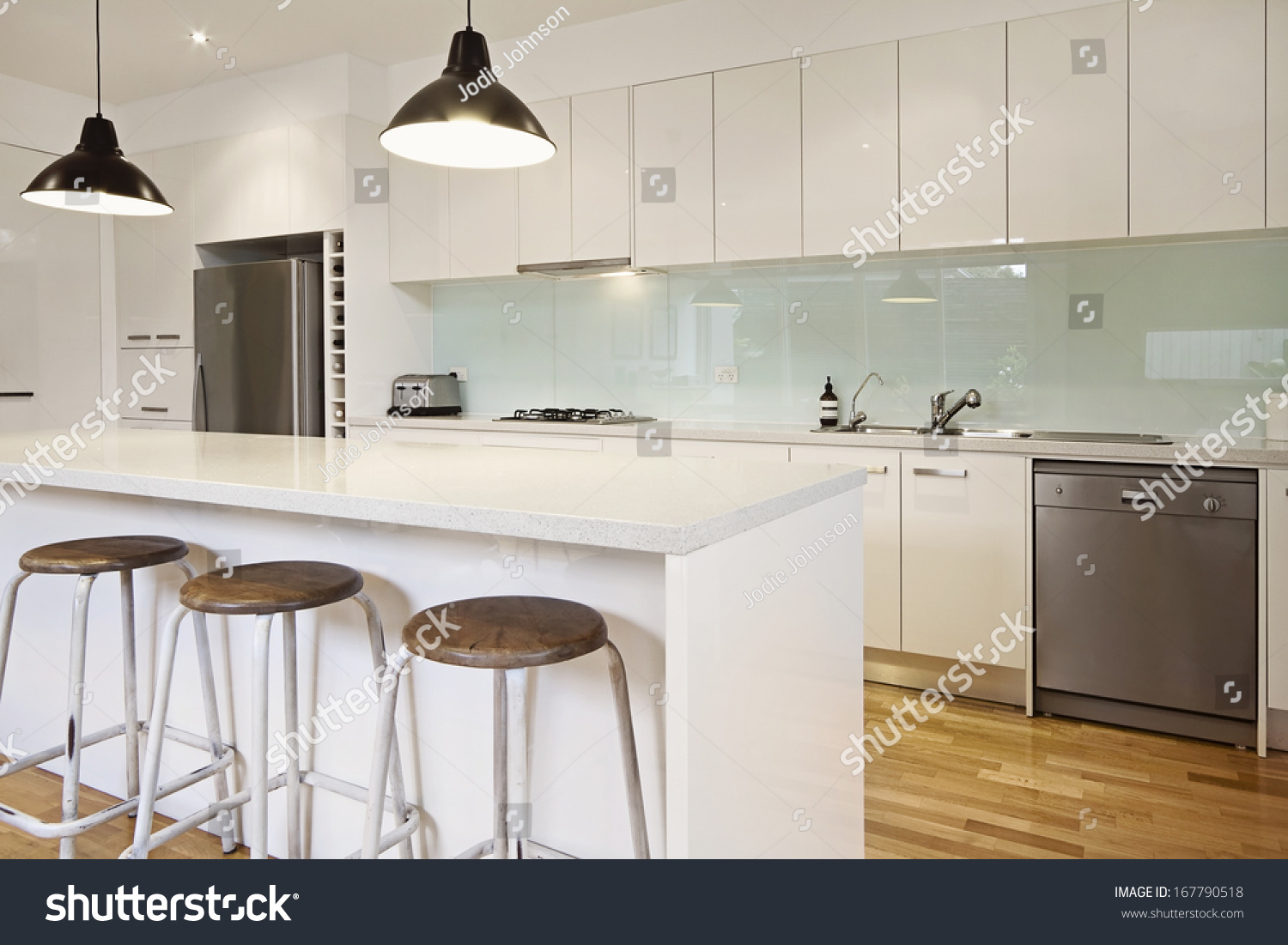 white contemporary kitchen with island and bar stools stock photo 167790518 shutterstock. Black Bedroom Furniture Sets. Home Design Ideas