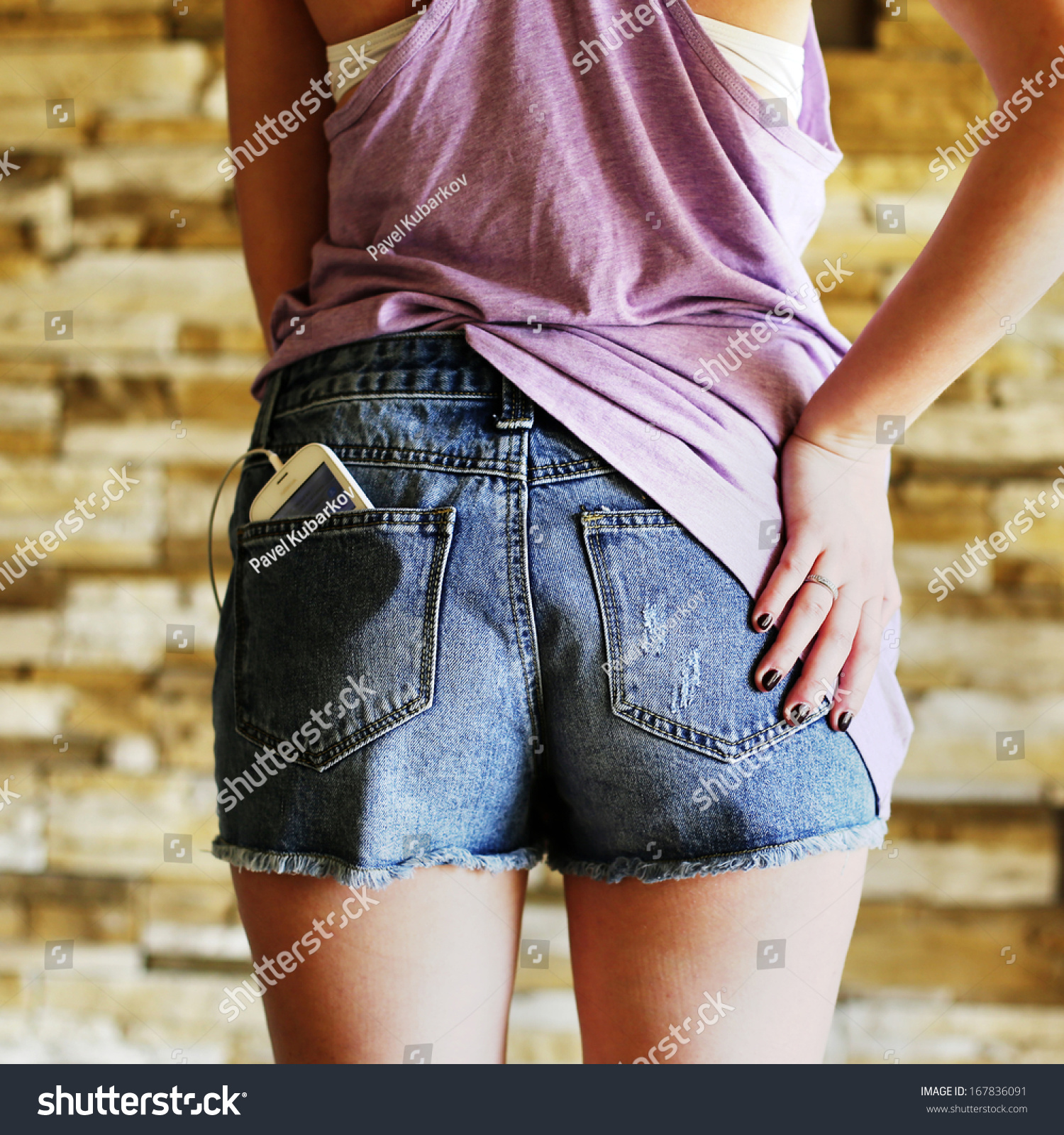 A part of a back and ass in shorts