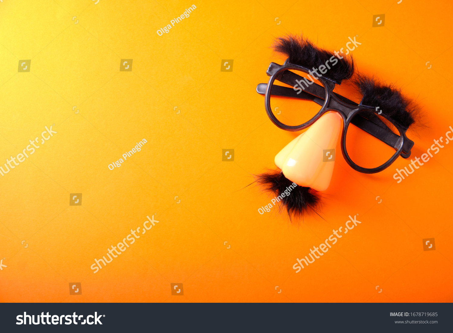 Overhead glasses, nose and mustache for April 1, April Fool's Day, on orange background #1678719685