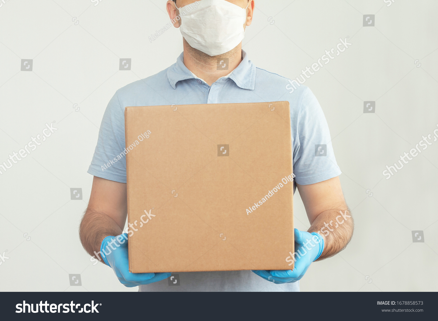 Delivery man holding cardboard boxes in medical rubber gloves and mask. copy space. Fast and free Delivery transport . Online shopping and Express delivery . Quarantine  #1678858573
