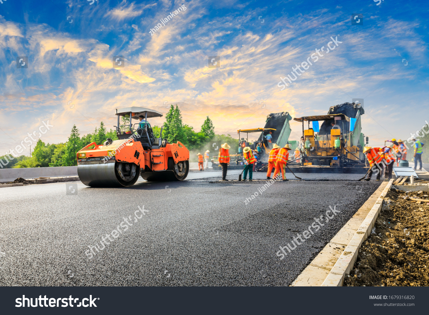 Construction site is laying new asphalt road pavement,road construction workers and road construction machinery scene.highway construction site landscape. #1679316820