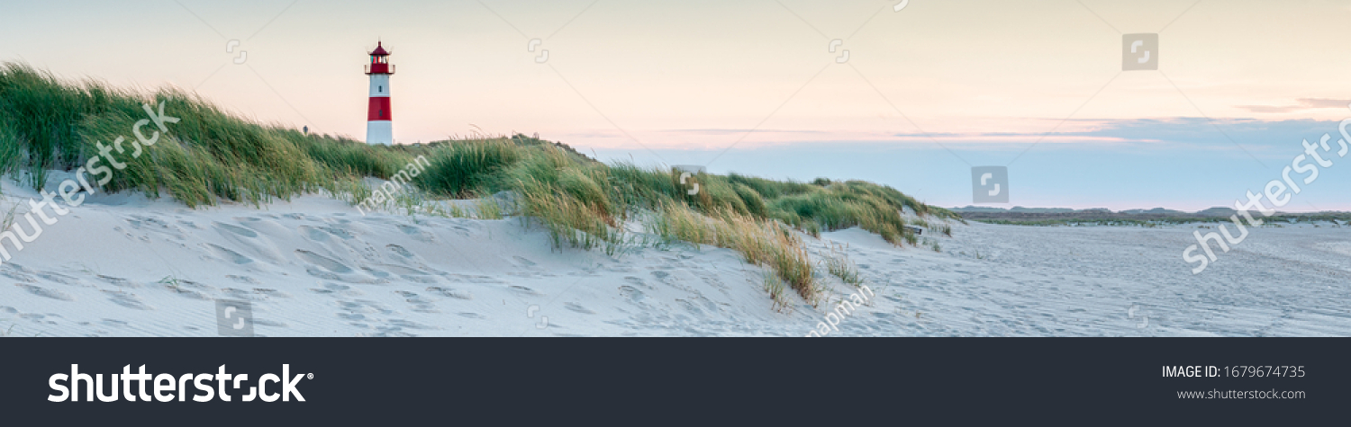 Panoramic view of a lighthouse standing at the coast of Sylt, North Sea, Germany #1679674735