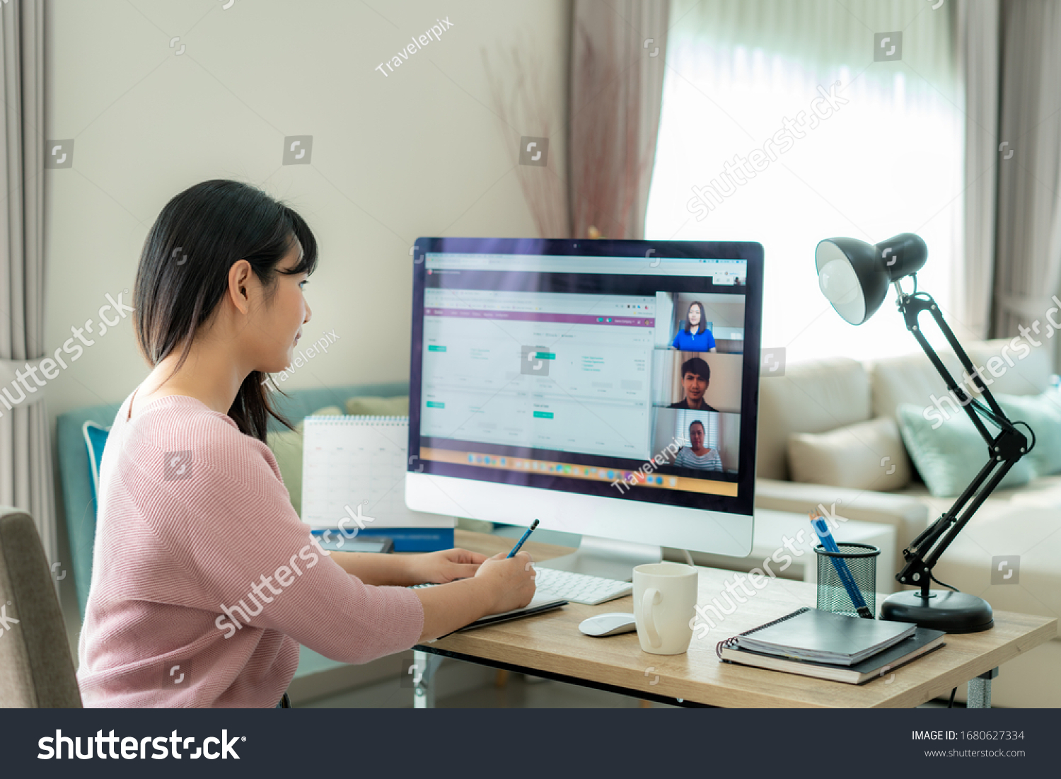 Asian business woman talking to her colleagues about plan in video conference. Multiethnic business team using computer for a online meeting in video call. Group of people smart working from home.  #1680627334