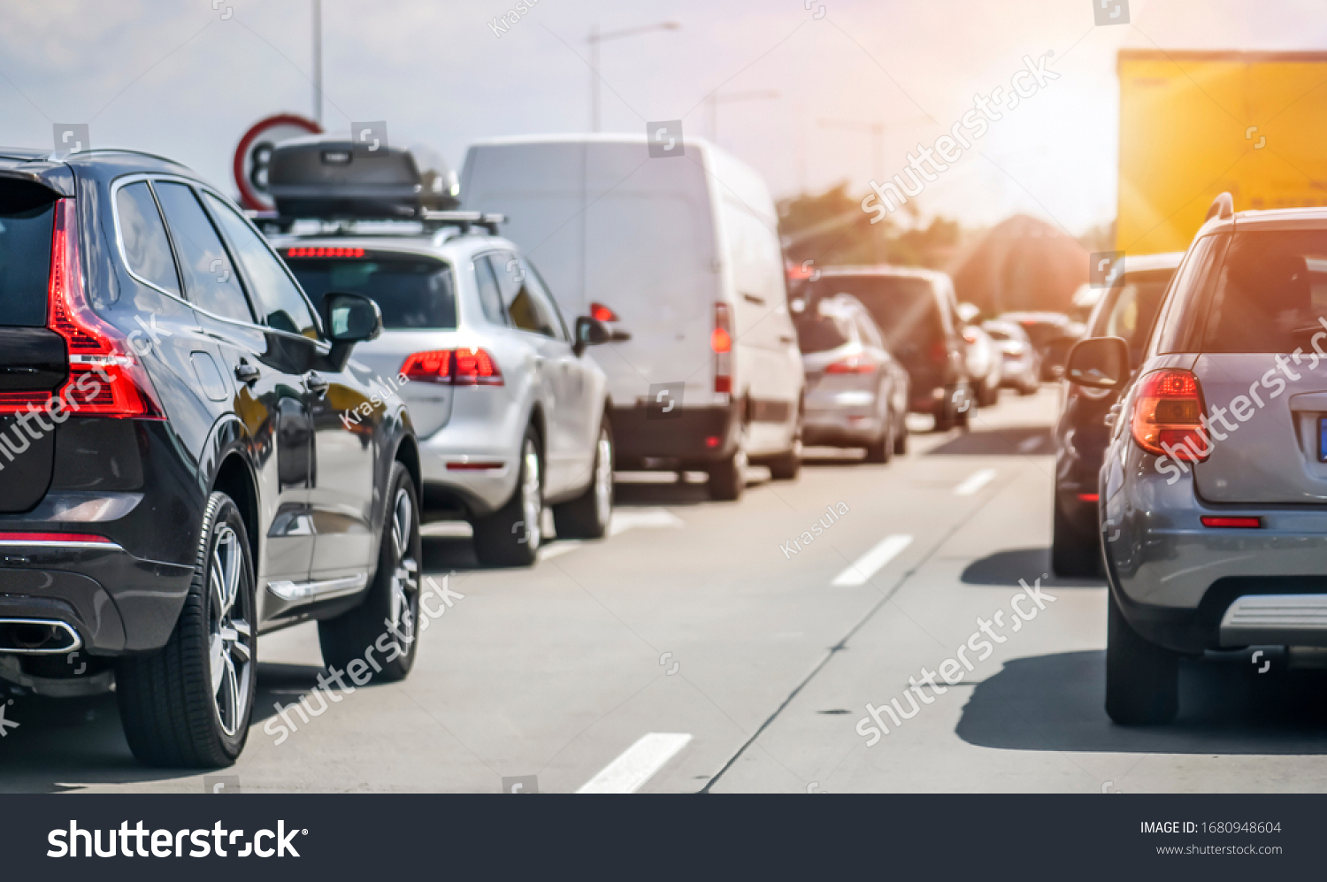 Cars rush hours city street. Car on highway in traffic jam on road. #1680948604