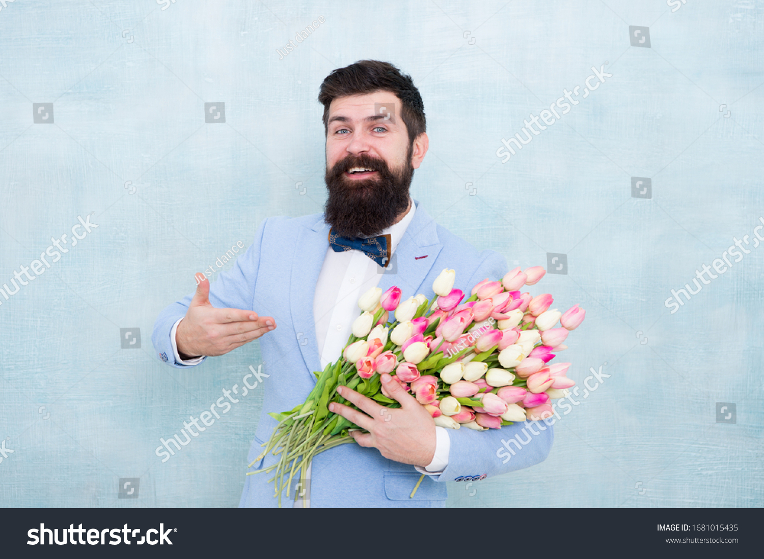 Tulips for Valentine. Happy hipster presenting flowers blue background. Valentines bunch. Valentine gift. My love, my Valentine. Be my Valentine. Flower shop. Floral delivery on Valentines day. #1681015435