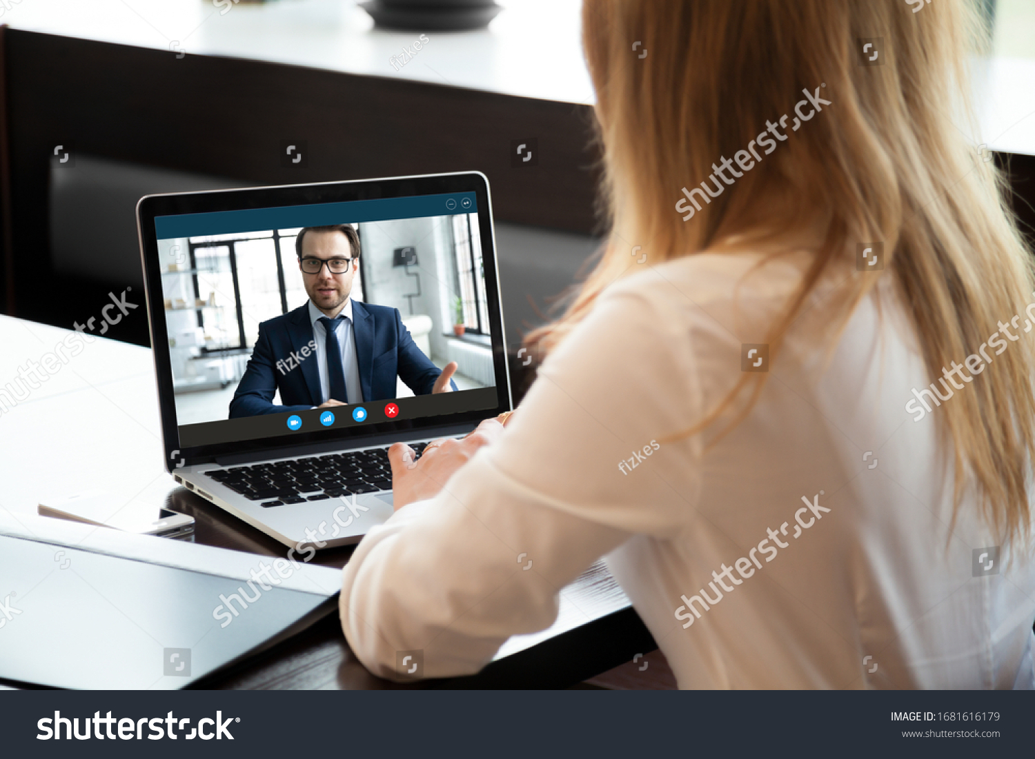 Back view of young businesswoman talk with male business partner using video call on modern laptop, female employee speak consult with businessman on webcam conference, online consultation concept #1681616179