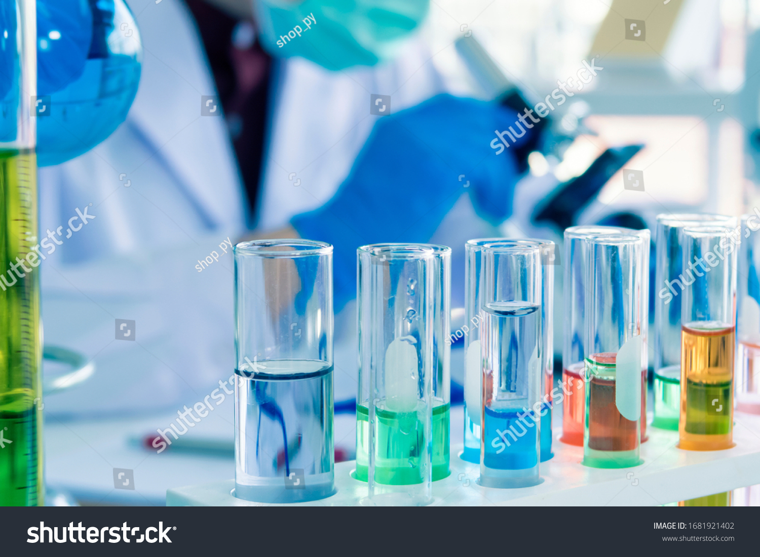 Close up of Red, pink, green, orange blue color liquid medicine in Test tube in rack on chemical table in the modern laboratory room. The education Chemistry and medical science research concept. #1681921402