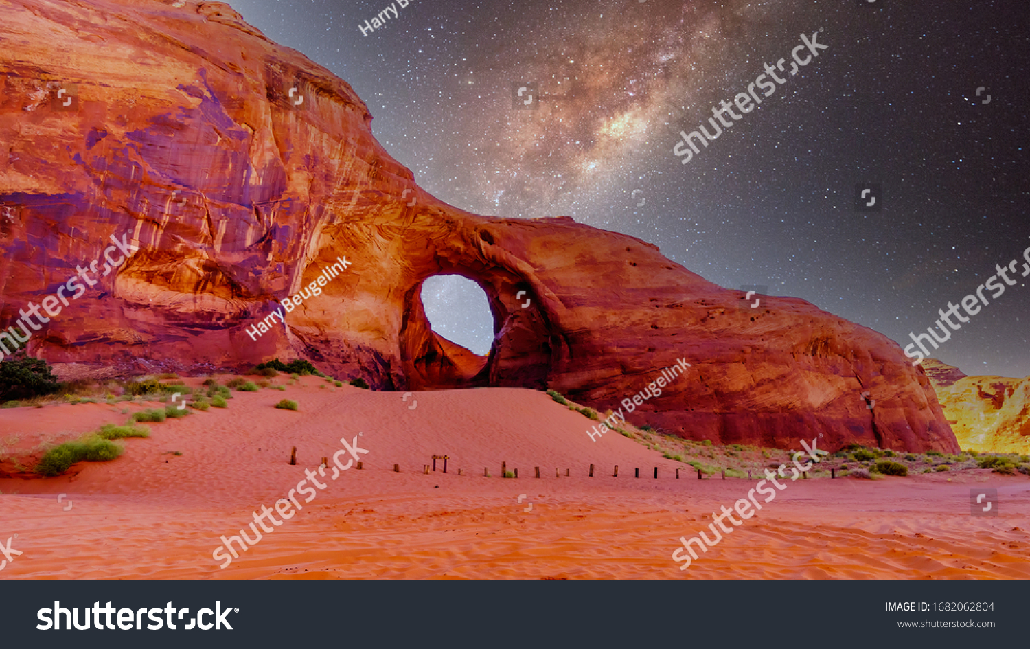 Starry Sky behind the Ear of The Wind, a hole in a rock formation in Monument Valley Navajo Tribal Park on the border of Utah and Arizona, United States #1682062804