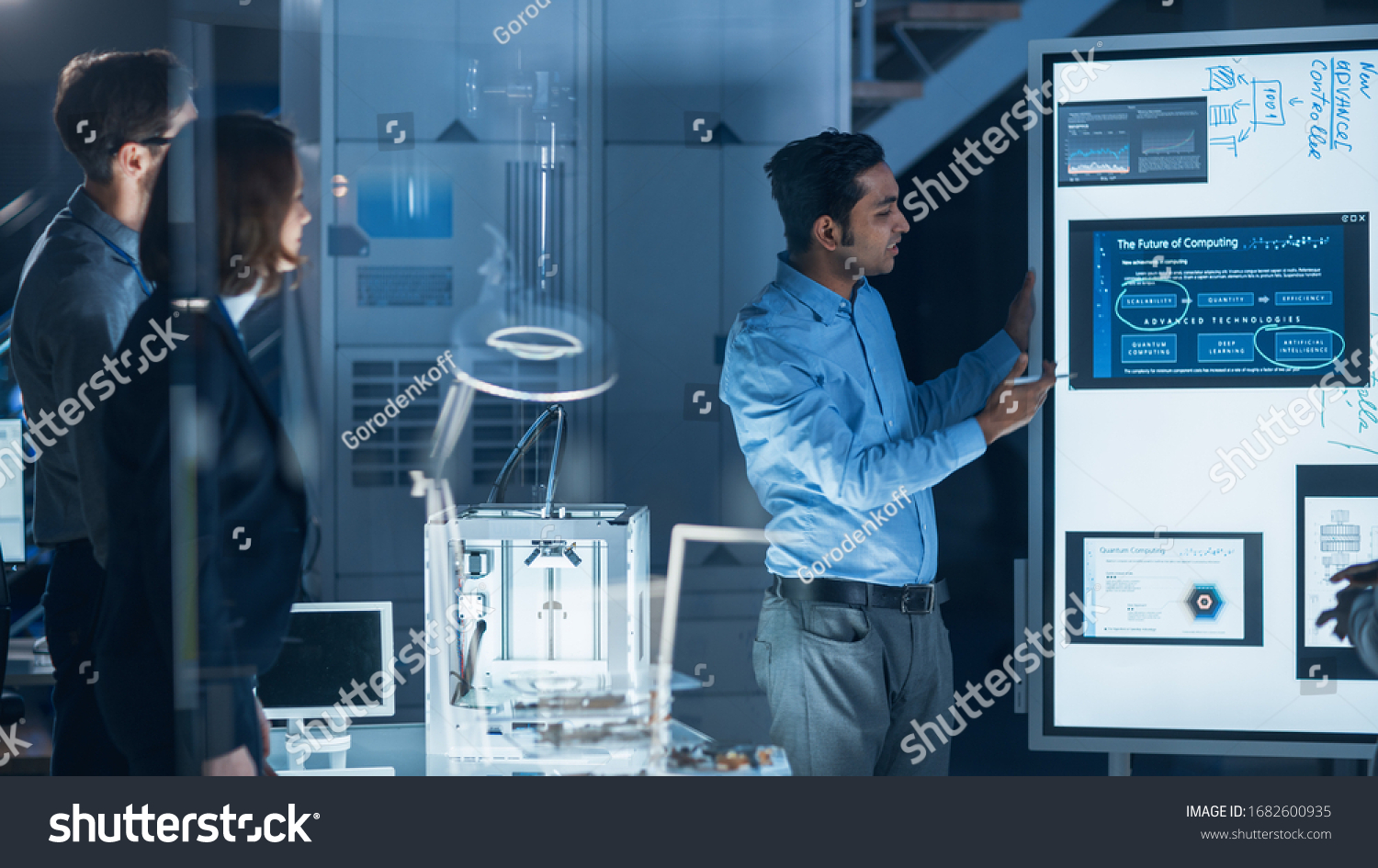 Engineers Meeting in Technology Research Laboratory: Male Engineer Leads Presentation Using Digital Whiteboard, Shows Machine Blueprint, Data Analytics and Neural Network while Colleagues Listening #1682600935