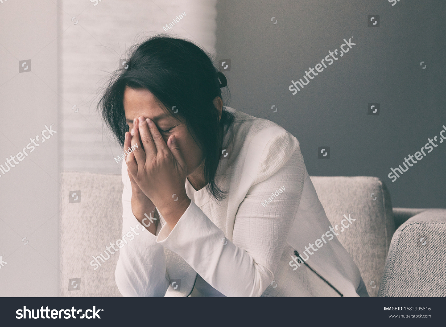 Coronavirus COVID-19 impact on retail businesses shut down causing unemployment financial distress. Depressed crying business woman stressed with headache. #1682995816