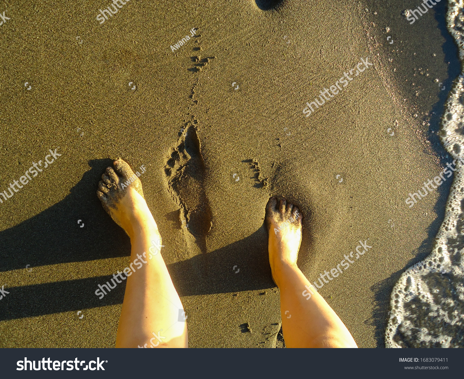 stock-photo-female-feet-and-footprints-i