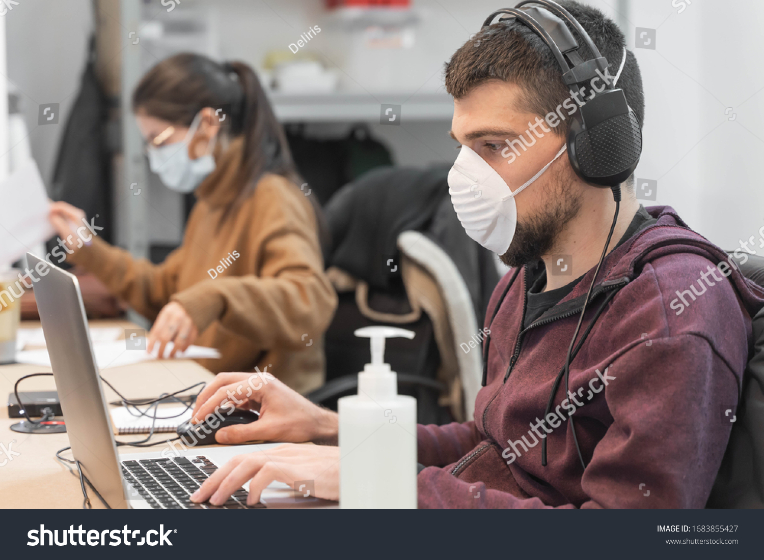 Coronavirus. Business workers working from home wearing protective mask. Small company in quarantine for coronavirus working from home with sanitizer gel. Small company concept. #1683855427