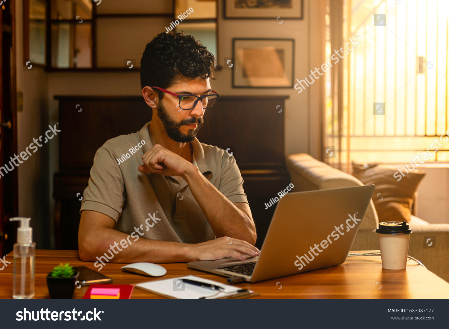 Handsome model with beard at his workplace. Home office concept. #1683987127