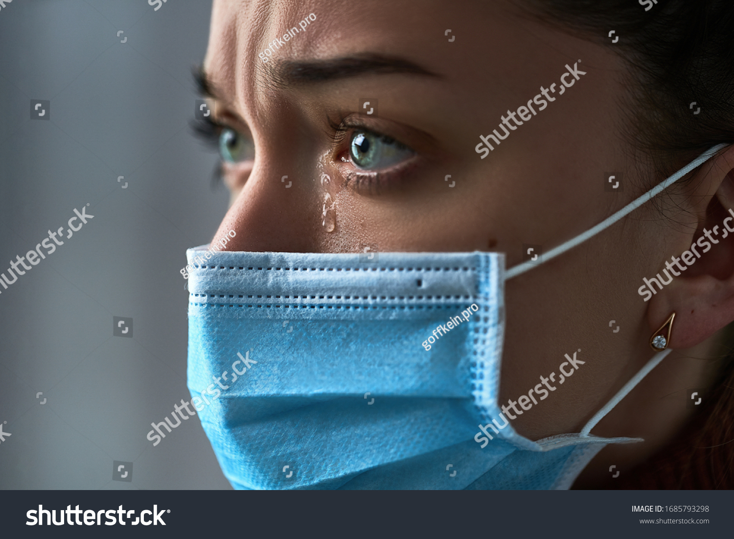 Upset depressed melancholy sad crying woman in protective face mask with tears eyes during serious illness, coronavirus outbreak and flu covid-19 epidemic. Health problems difficulties #1685793298