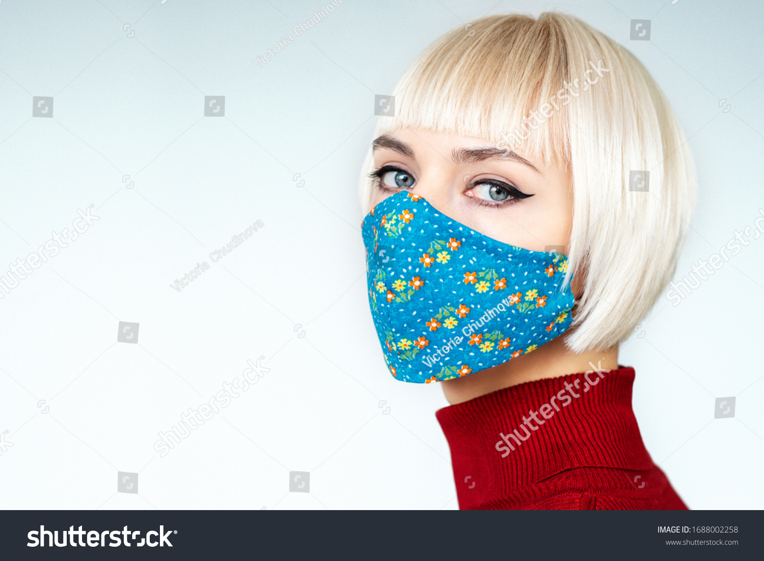 Woman wearing stylish handmade protective face mask. Fashion during quarantine of coronavirus outbreak. Copy, empty space for text