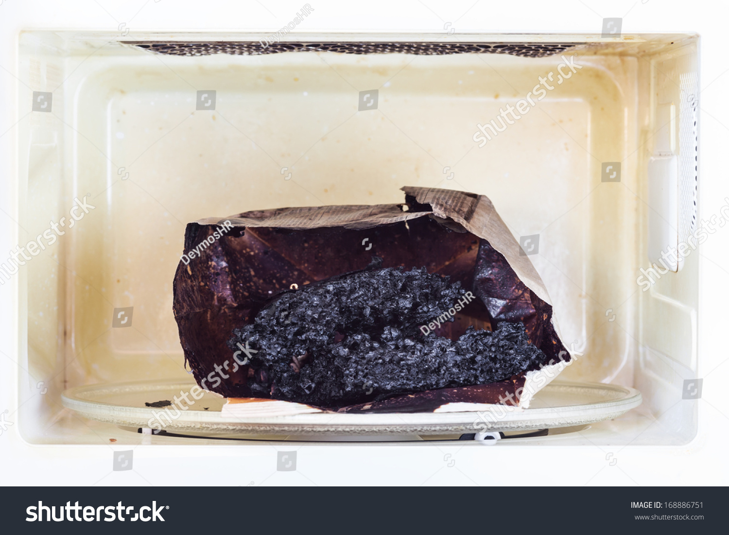 Dirty Microwave Oven ~ Burnt paper bag with melted and popcorn in the