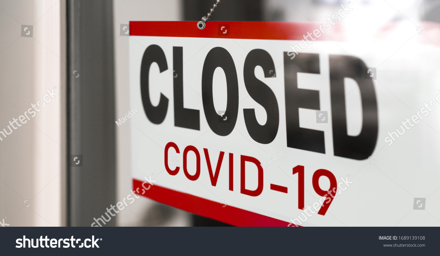 Closed businesses for COVID-19 pandemic outbreak, closure sign on retail store window banner background. Government shutdown of restaurants, shopping stores, non essential services. #1689139108