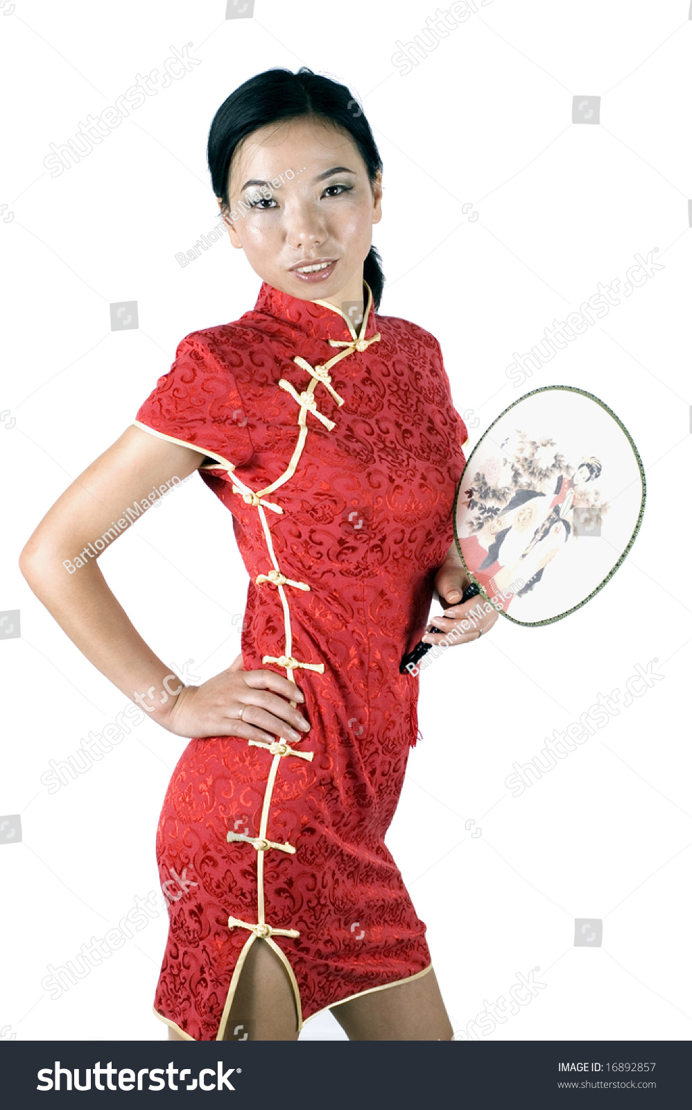 3c637e553 Asian girl in traditional Chinese dress called QiPao, holding simple fan.