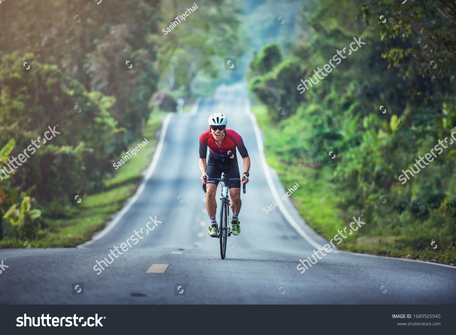 Cycling competition, cyclist athletes riding a race at high speed on mountain road, Sportsmen bikes in the morning, #1689565945