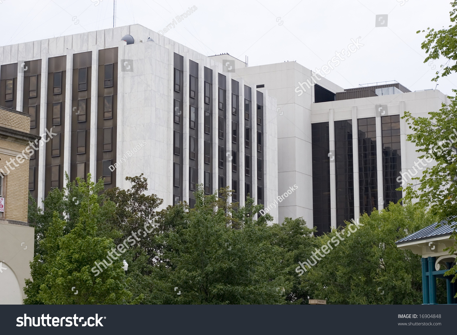 Black Marble Buildings : A modern white marble building with black windows stock