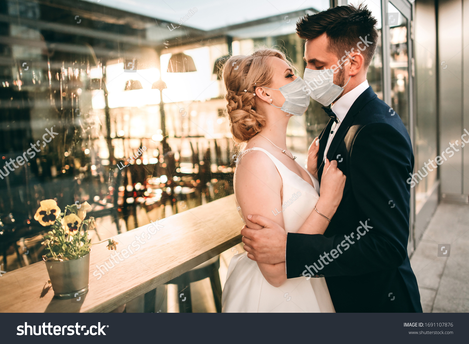 Young loving brides walking in modern city medical masks during quarantine on their wedding day. Coronavirus, disease, protection, sick, illness flu europe celebration canceled, surgical protective #1691107876
