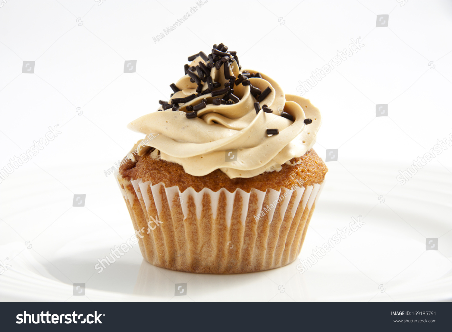 Homemade Cupcake With Toffee Frosting And Chocolate Sprinkles Stock ...