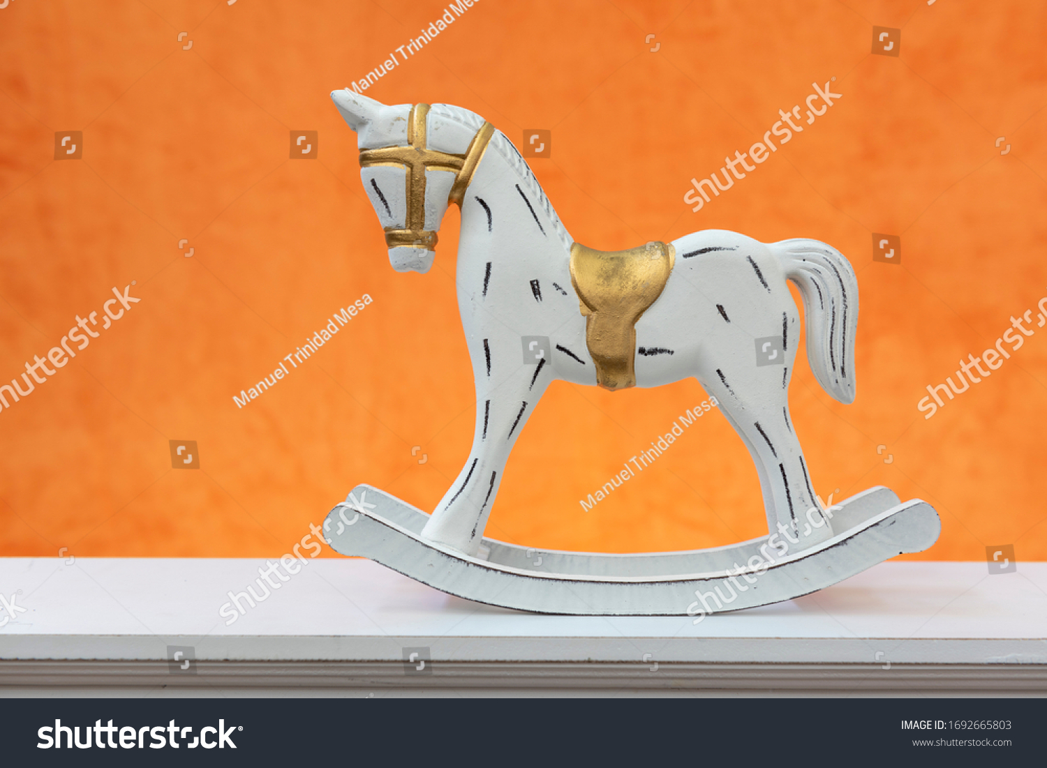 Rocking horse, white with black spots